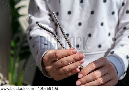 Woman Holding Reusable Metal Straw. Female Hand On Reusable Collapsible Drinking Straw. Eco Lifestyl