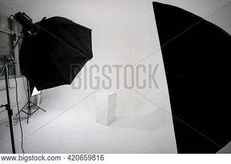 Photo Studio, Lighting Fixtures, White Endless Background, White Cubes. A Professional Studio Equipm