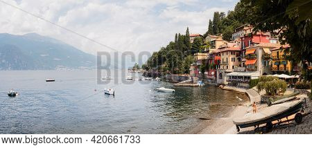 Cloudy And Sunny Day Of The Como Lake With The Village Of Varenna, Italy, With Soft Sunlight And Mou