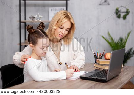 School, Homework And Distance Education Concept - Beautiful School Girl Doing Homework With Her Moth
