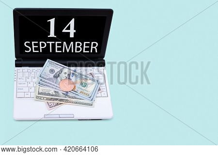 14th Day Of September. Laptop With The Date Of 14 September And Cryptocurrency Bitcoin, Dollars On A