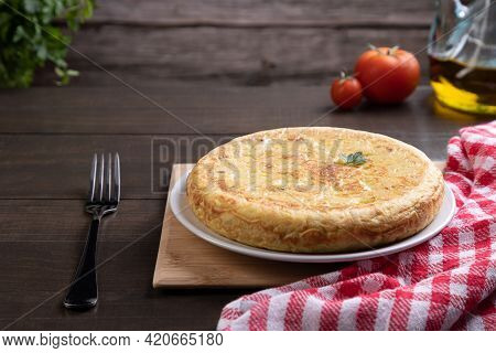 Traditional Spanish Omelette Dish, On Rustic Background With Copy Space. Spanish Cuisine.
