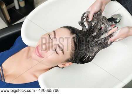 Hairdresser Working With Glamour Brunette Woman In Professional Hair Salon.