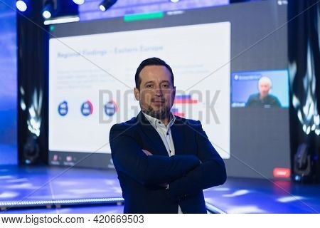 Businessman portrait on conference meeting, presenter joining a seminar via video conference call in empty convention center. Online webinar or seminar via social network broadcast in new normal