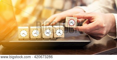 The Businessman At The Computer Keeps The Time. Time Concept For Business And Industry