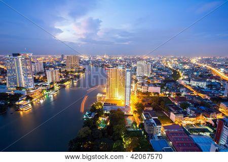 Aerial view of Bangkok Skyline along Chaophraya River at dusk poster