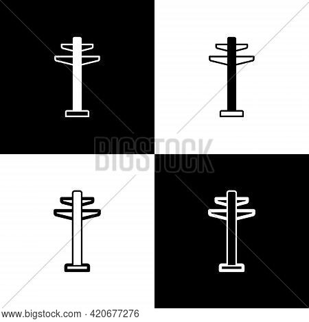 Set Electric Tower Used To Support An Overhead Power Line Icon Isolated On Black And White Backgroun
