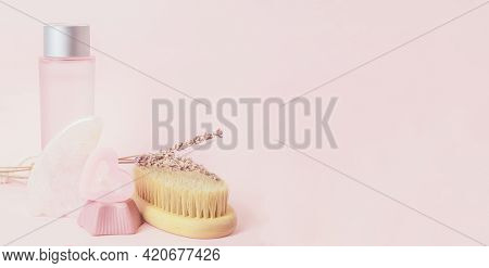Body Care Products On A Pink Background. Gua Sha, Handmade Soap, Candle, Wooden Brush For Body Dry M