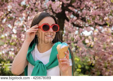 Young Woman With Icecream In Beautiful Park