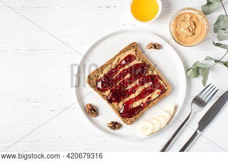Homemade Peanut Butter Sandwich With Raspberry Jam And Banana.