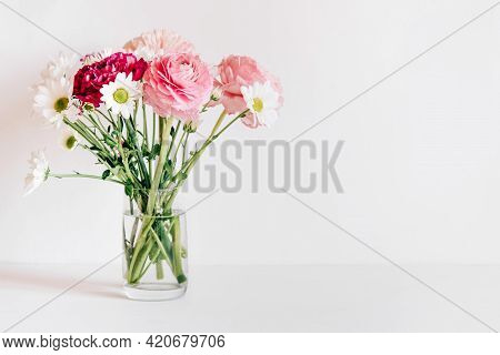 A Bouquet Of Fresh Spring Flowers On A White Table.