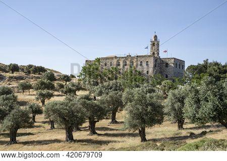 Jerusalem, Israel - May 6th, 2021: The Mar Elias Greek Orthodox Monastery , And An Olive Grove Besid