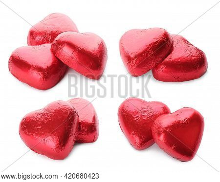 Set With Delicious Heart Shaped Chocolate Candies Wrapped In Red Foil On White Background