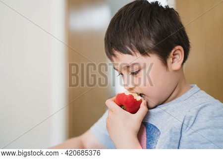 Healthy Child Eating Red Apple, Cute Boy Eating Fresh Fruit For His Snack, Close Up Kid Face Eating