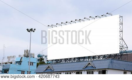 Blank Billboard On The Roof Of The Building.