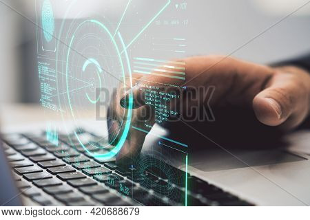 Cyber Surveillance Concept With Hologram Of Data Processing On Man Hand With Laptop Background. Doub