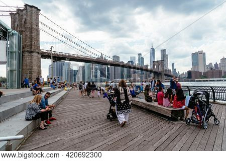 New York City, Usa - June 24, 2018: People Enjoying At Waterfront Of Dumbo Area In Brooklyn. View Ag