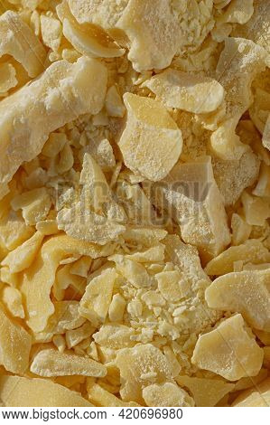 Pieces Of Crushed Cocoa Butter. Chopped Cocoa Oil. The Concept Of Natural Skin And Hair Care. Vertic