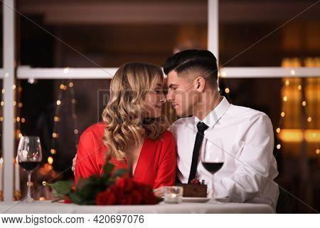 Lovely Couple Having Romantic Dinner On Valentine's Day In Restaurant