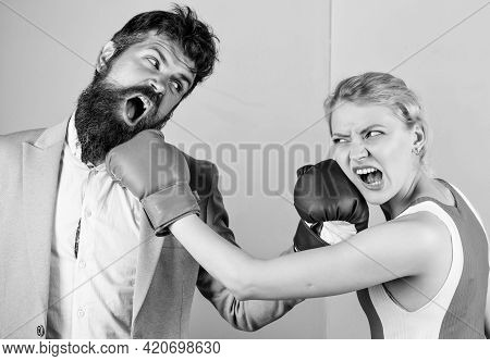 Boxers Fighting In Gloves. Domination Concept. Gender Equality. Man And Woman Boxing Fight. Couple I