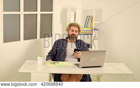 Work Is Amazing. Relaxed Man Hipster Browsing Through Internet During Free Time At Home. Using Lapto
