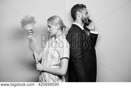 Housekeeping Routine. Housewife And Businessman. Career And Housekeeping. Family Couple. Wife Stand