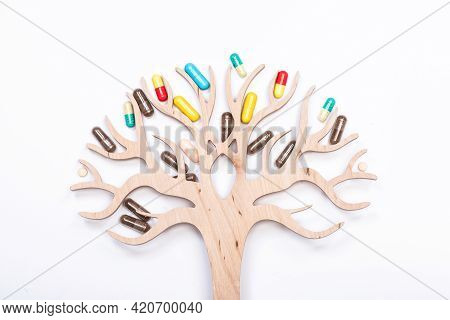 Tree Of Life. Wooden Tree Decorated With Assorted Pills. Medical Products. Medicaments. Medication