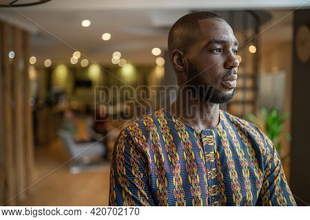 Portrait Of A Handsome Black African Business Man Wearing Traditional African Clothing Looking Into