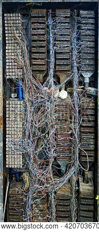 An Ancient Box Of An Obsolete Analogue Dial-up Telephone Exchange With A Lot Of Messy Wires