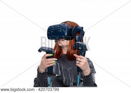 The Girl Plays In Modern Glasses With A Virtual Screen And Wireless Controllers, Imitating Hand Move