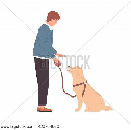 Young Man Teaching And Training His Dog To Sit By Hand Gesture Command. Well-behaved Doggy And Pet O