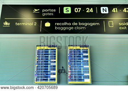 Lisbon, Portugal- March 11, 2020: Information Panel For Departures And Arrivals Next To A Clock At T