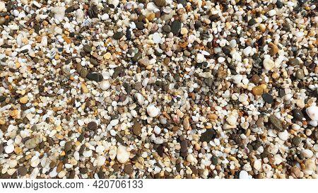 Sea Pebble Texture. Small Rocks. Small Multicolored Pebble Stones. Close Up Beach Stones Surface. Hi