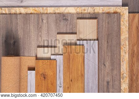 Laminate floor and cork roll on wood osb background texture. Wooden laminate floor and chipboard with copy space