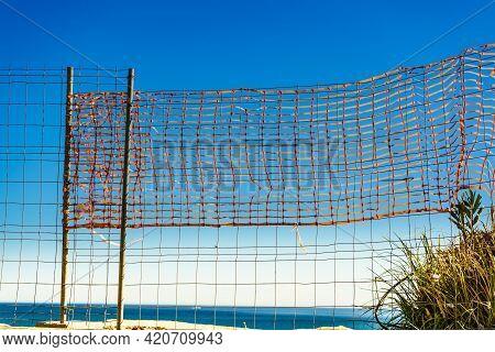 Volleyball Summer Sport Equipment. Net Netting Wire On Sandy Beach Outdoor. Active Lifestyle.