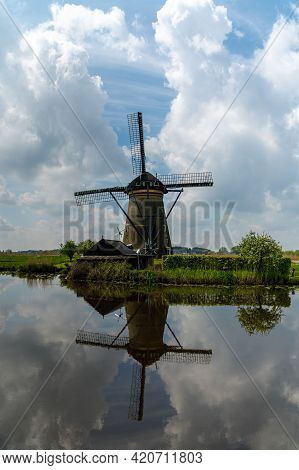 View Of A Historic 18-century Windmill At Kinderdijk In South Holland