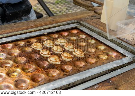 Close Up Of A Male Baker Preparing Fresh The Sweet Dutch Batter Treat Called Poffertjes On A Special