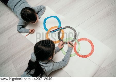 St. Petersburg, Russia, May 25, 2021: Childrens Drawing A Symbol Of Sports Olympics. Children Draw O