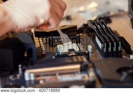 Application Of Thermal Paste On The Computer Processor Chip For High-quality Cooling. Spreading Of T