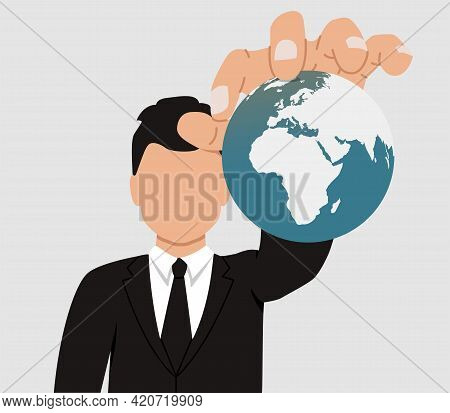 The Concept Of World Domination. A Businessman Holds The Planet Earth In His Hands. The Faceless Man