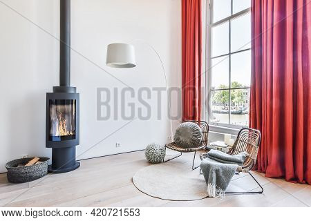 Bright Living Room. Chairs Near Fireplace. Comfortable Wooden Chairs With Pillows And Blankets Near
