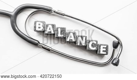 Stone Block Form Word Balance With Stethoscope. White Background. Medical Concept. Ability To Mainta