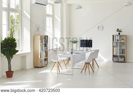 Interior Of A Modern White Business Office. Empty Light Spacious Conference Room In Office With Desk