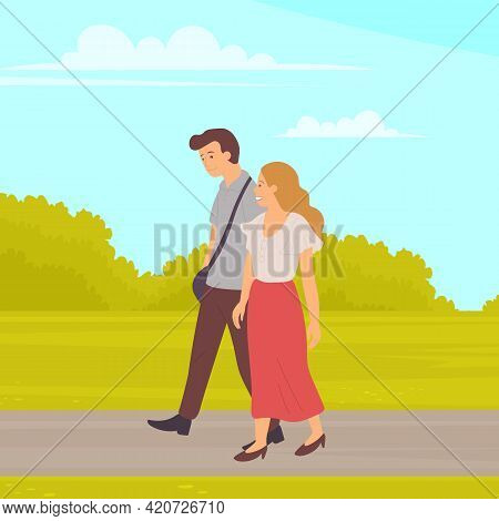 Couple In Relationship Talking Walking In City Park Together. Young Guy And Girl Holding Hands Walki