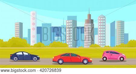 Cars Drive On An Asphalt Road Against Background Of Tall Buildings Of City Landscape. Urban Road And