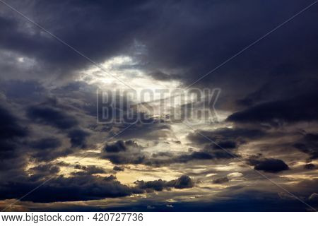 Sky Obscured By Dark Clouds . Wispy Storm Clouds In The Twilight