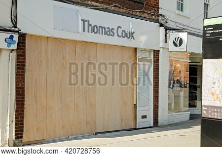 Wokingham, Uk - February 28, 2021: A Boarded Up Branch Of The Defunct Travel Agency Thomas Cook In W