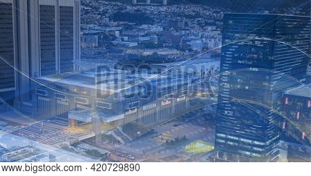 Composition of digital light trails over cityscape. global data processing and digital interface concept digitally generated image.