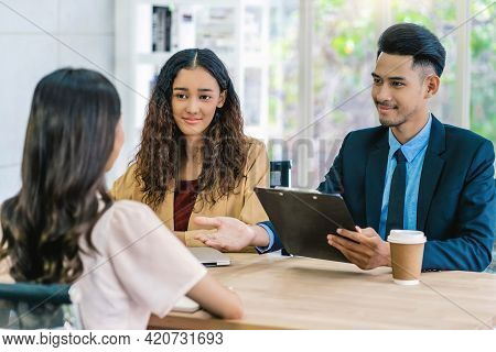 Senior Asian Manager Explaining Or Answering About Job Description And Benefits To Young Asian Woman