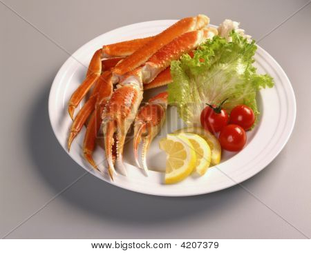 Snow Crab Legs On A White Plate